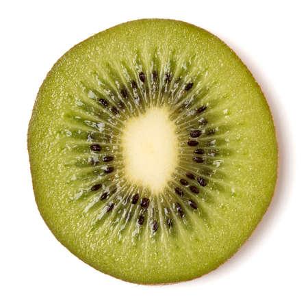 One kiwi fruit slice isolated on white background closeup. Kiwifruit slice flatlay. Flat lay, top view.