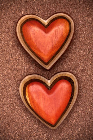 Two wooden hearts on rustic wood background. Valentines days concept.  Love symbol. Greeting card. Standard-Bild