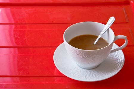 a cup of coffee on red floor Stock Photo - 8898753