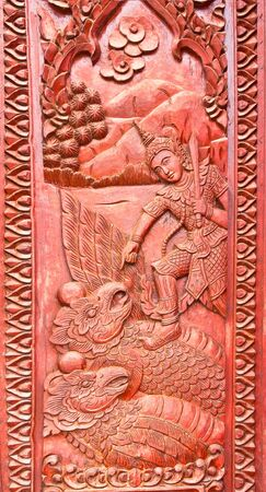 Divinity to step on garuda,carved art style of thialand photo