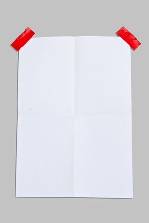 note paper and 2 red tapes on white background