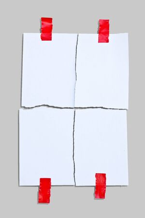 note paper and red tape on white background  photo