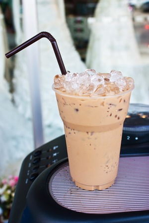 Cold coffee drink with ice on coffee machine
