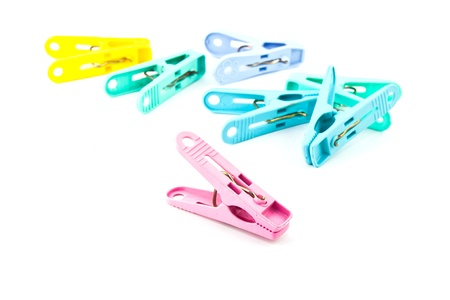 clench: Colour clothes-peg isolated Stock Photo