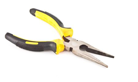 Rusty Yellow Pliers isolated on white background photo
