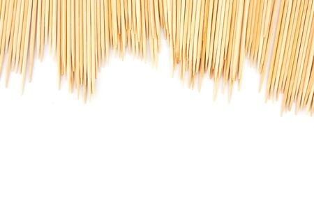Many scattered toothpicks, isolated on white Stock Photo - 13916174