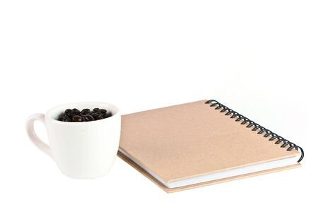 paper notebook front cover and offee feed in cap Stock Photo - 14217257