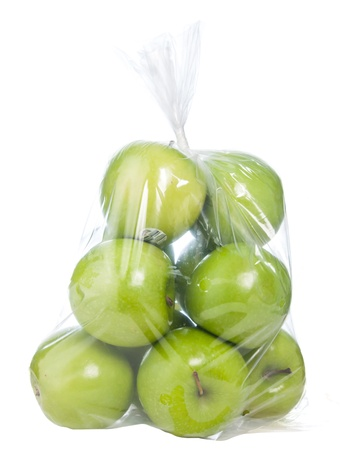 Green apples in plastic bag on white background
