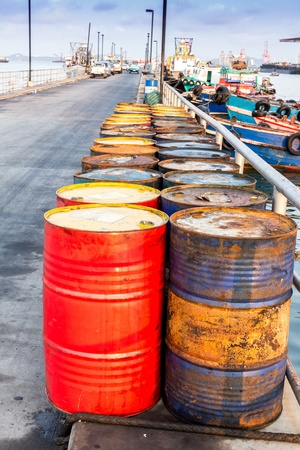 Oil drums on jetty,chonburi in thailand photo