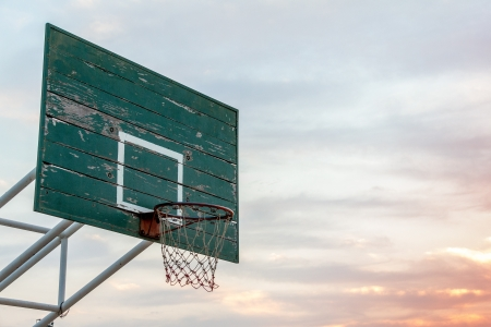 Outdoor Basketball Hoop in evening time.