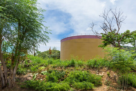 Storage tank on natural outdoor photo