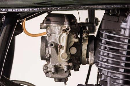 men repair a caburator motorcycle photo