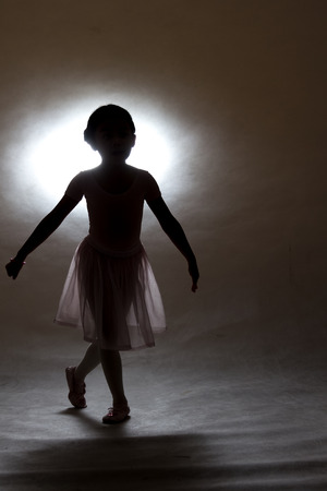 Silhouette of a little girl in ballet