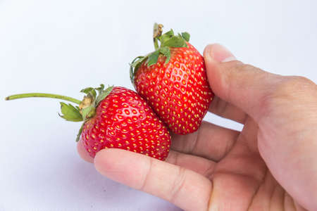 Handful of delicious red strawberries