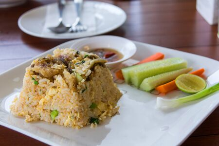 slivers: fried rice with trichogaster pectoralis thai food on restaurant Stock Photo