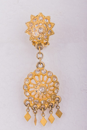 accesory: beautiful gold earring isolated white background accesory wedding