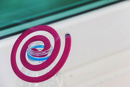 pink mosquito repellent on bottle water Stock Photo