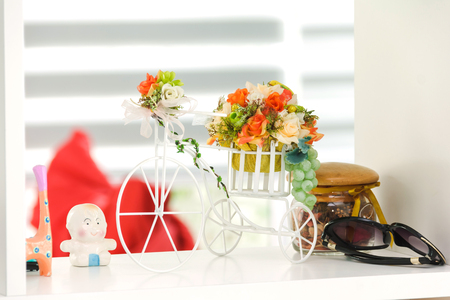 white bicycle with bouquet flower decoration in shelf