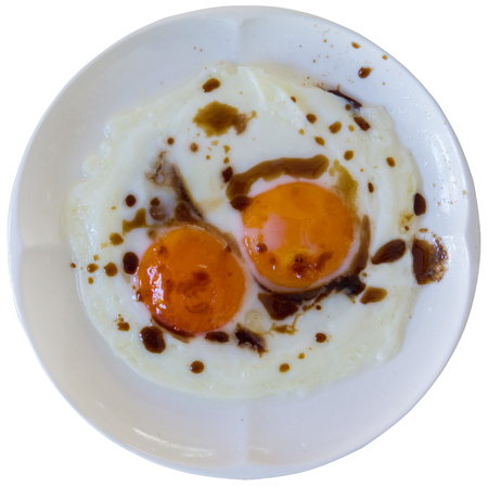 fired egg with sause on white dish
