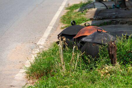 rubber bin at side of street in city