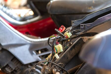 wiring socket of motorcycle waiting repair by technician Banco de Imagens