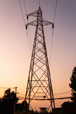 silhouette style, Electric pole in twilight time Banco de Imagens
