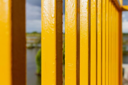 yellow metal porch reflect with sunlight on outdoor Banco de Imagens