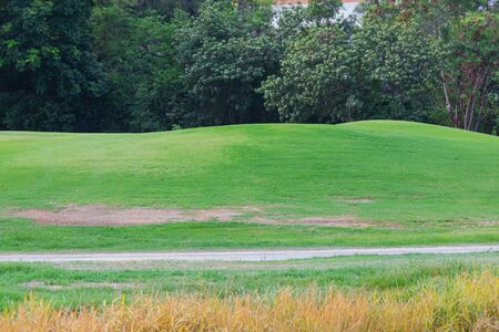 sand mound in golf course with lush grass, are perfect for doing sports during the day