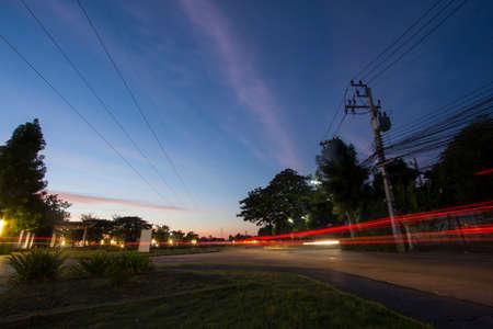 night scene art from vehicle light at village area