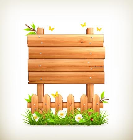 Cartel de madera en la hierba
