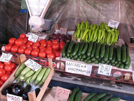 Cucumbers, potatoes, zucchini, eggplants on a bazar photo