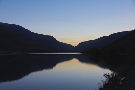 snowdonia: Tal-y-llyn lake in Snowdonia, North Wales, just before sunrise on what promises to be an unusually nice and sunny day.