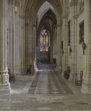 light columns: Sun is shining through 13th century stained glass on the aisle pillars of Abbaye de la Trinite�?� in Vendo�?�me.