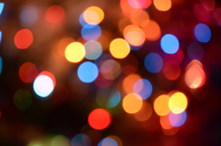 Bright abstract circular bokeh background blur on a dark background