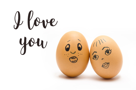 Eggs with painted emotions, psychology of feelings of love and communication on a white background, with the text I love you, selective focus 版權商用圖片