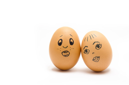 Eggs with painted emotions, psychology of feelings of love and obsheniya on a white background, with space for text, throw away focus