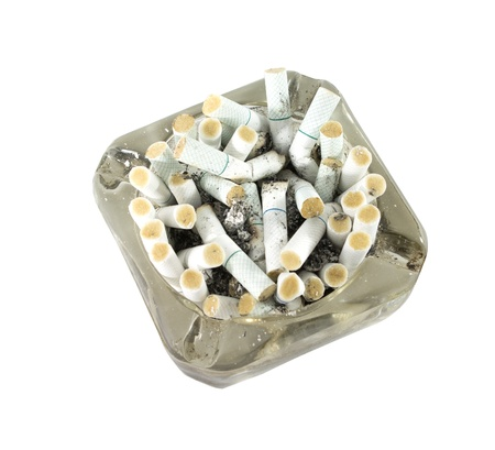 Cigarette butt in ashtray isolated on white background photo