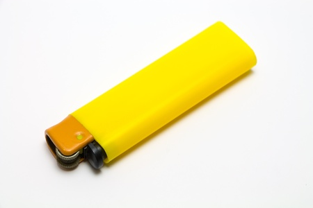 Yellow Lighter isolate on a white background. Stock Photo - 19451071
