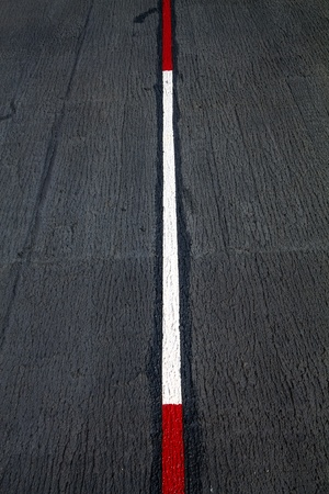 Red and white traffic lines on Asphalt road  photo
