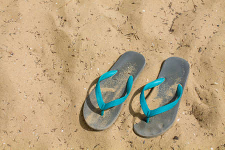 Beach Sandals on Sand background photo