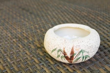 habituation: Single ashtray is empty on the table. Stock Photo