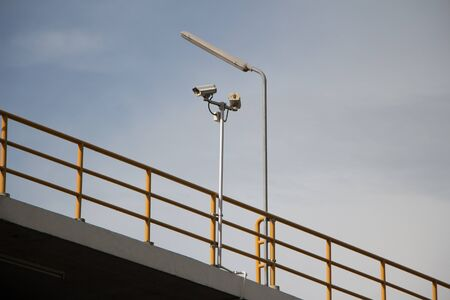 carpark: CCTV security cams at carpark and blue sky