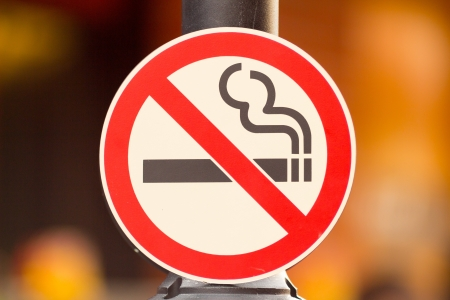 No smoking Sign On Pole in Public Place. photo