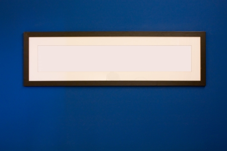 Long Wooden Frame on blue wall  photo