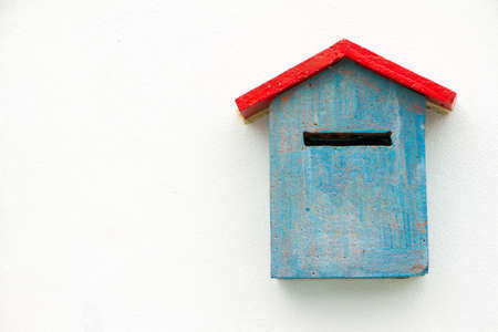 Blue Concrete Mailbox on white wall. photo