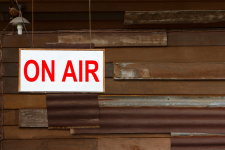on air sign: On Air Sign with old wooden wall background Stock Photo