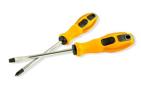 yellow screwdrivers isolated over white background. photo