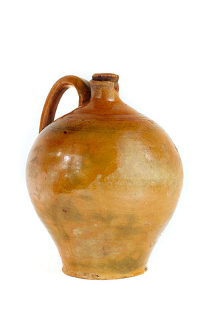 ewer: old pottery jug for wine isolated on white