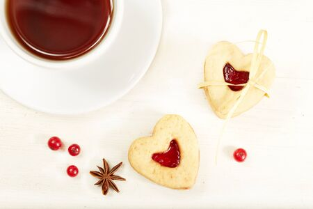 st  valentines day: Heart shaped cookies and cup of tea