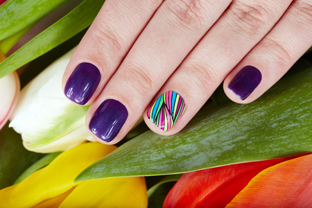 artificial nails: Nails with beautiful artificial manicure and colorful tulip flowers